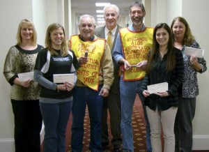 Knights of Columbus present checks to local teachers.
