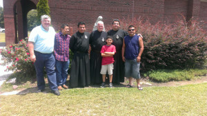 Father Peter Grace with some knights.